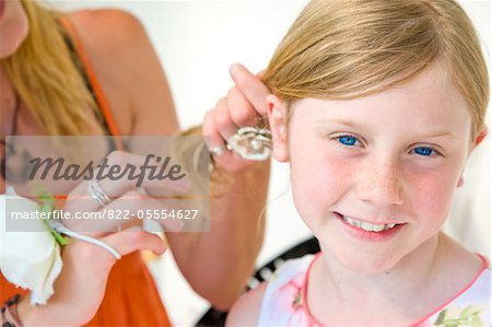 Mother Fixing Daughter Hair Stock Photo - Rights-Managed, Image code: 822-05554627