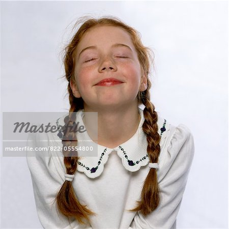 Smiling Girl with Eyes Closed and Head Tilted Back Stock Photo - Rights-Managed, Image code: 822-05554800