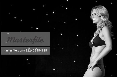 Beauty Contestant against Starry Backdrop, Side View Stock Photo - Rights-Managed, Image code: 822-05554815