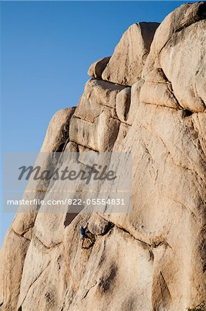 Man Climbing Rock Face Stock Photo - Rights-Managed, Image code: 822-05554831