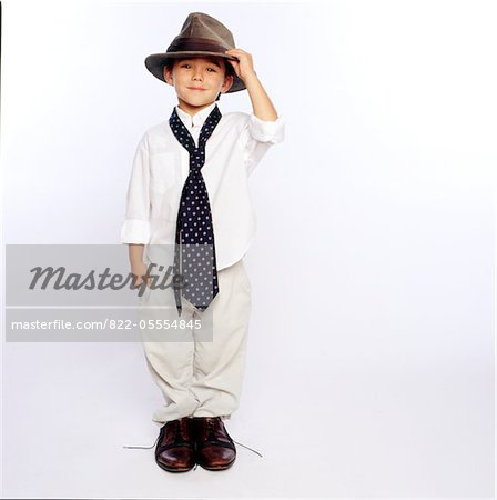Boy Wearing Oversized Man's Clothing Stock Photo - Rights-Managed, Image code: 822-05554845