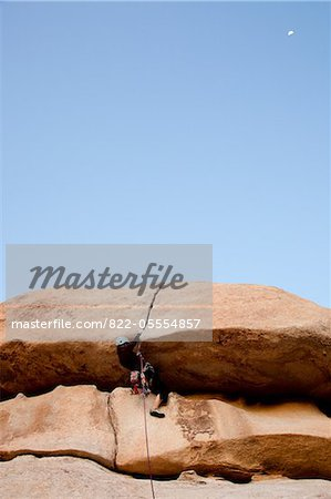 Man Climbing Rock Face Stock Photo - Rights-Managed, Image code: 822-05554857