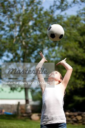 Girl Throwing Football Above Head Stock Photo - Rights-Managed, Image code: 822-05554897