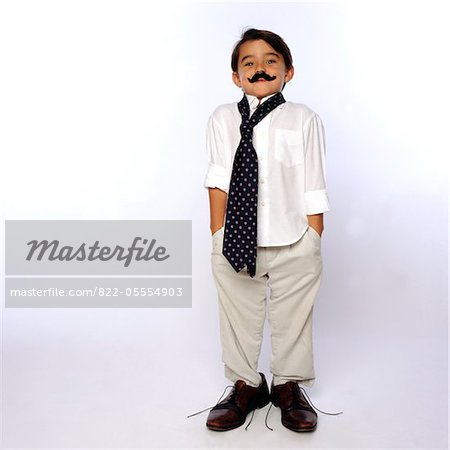Boy Wearing Fake Moustache and Oversized Man's Clothing Stock Photo - Rights-Managed, Image code: 822-05554903