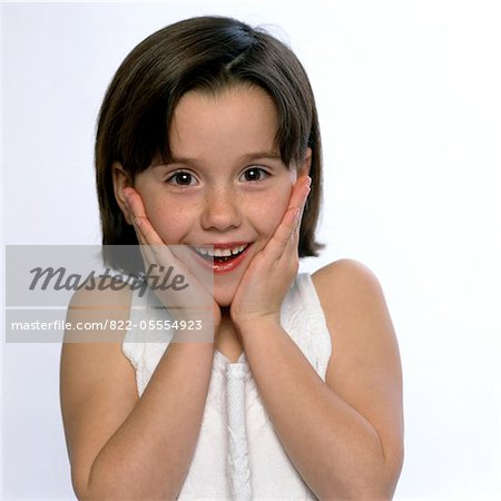 Smiling Girl with Hands on Face Stock Photo - Rights-Managed, Image code: 822-05554923