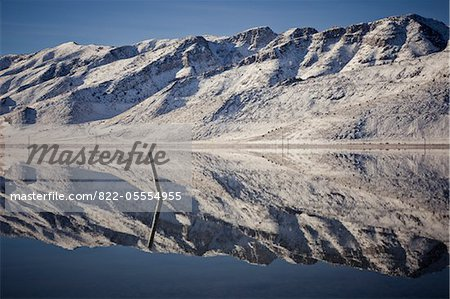 Snow Covered Mountains Reflecting in Lake Stock Photo - Rights-Managed, Image code: 822-05554955