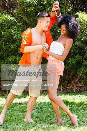 Young Couple Messing Around in Garden Stock Photo - Rights-Managed, Image code: 822-05554959