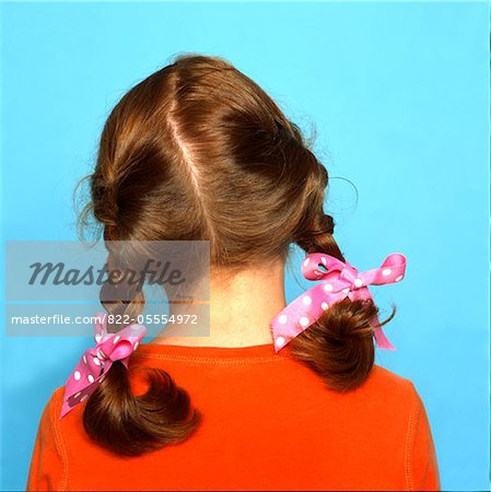 Back View of Girl's Head with Braids and Pink Ribbons Stock Photo - Rights-Managed, Image code: 822-05554972