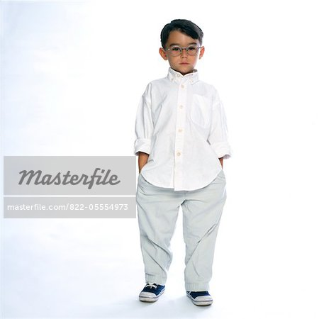 Boy Standing with Hands in Pockets Stock Photo - Rights-Managed, Image code: 822-05554973