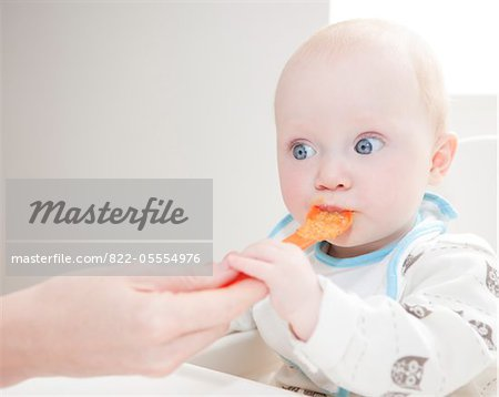 Mother Feeding Baby Stock Photo - Rights-Managed, Image code: 822-05554976