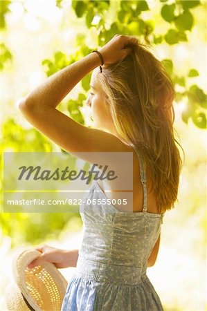 Teenage Girl with Hands on Hair  Outdoors Stock Photo - Rights-Managed, Image code: 822-05555005