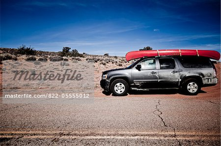Parked Car with Red Canoe on Roof Stock Photo - Rights-Managed, Image code: 822-05555012