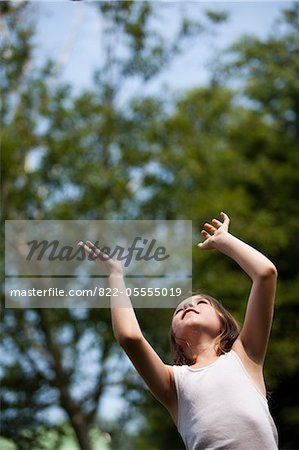 Young Girl with Arms Raised Looking Up Stock Photo - Rights-Managed, Image code: 822-05555019
