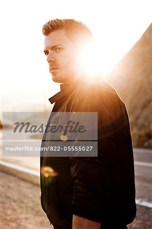Man Standing By Road Stock Photo - Rights-Managed, Image code: 822-05555027