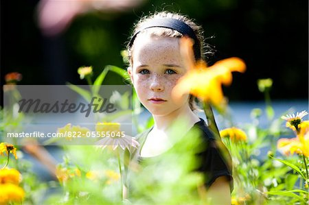 Girl Standing amongst Flowers