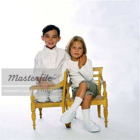 Boy and Girl Sitting and Holding Hands Stock Photo - Rights-Managed, Image code: 822-05555054