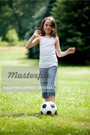 Young Girl Kicking Football in Park Stock Photo - Rights-Managed, Image code: 822-05555142