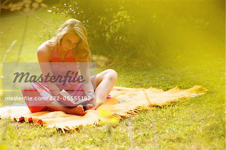 Teenage Girl Reading in Garden Stock Photo - Rights-Managed, Image code: 822-05555182