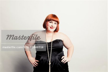 Woman Standing with Hands on Hips Stock Photo - Rights-Managed, Image code: 822-05948316