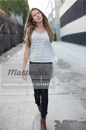 Young Woman Walking on Street Stock Photo - Rights-Managed, Image code: 822-05948379