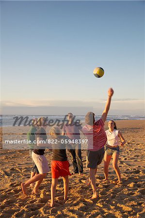 Group of People Playing Volleyball on Beach Stock Photo - Rights-Managed, Image code: 822-05948397