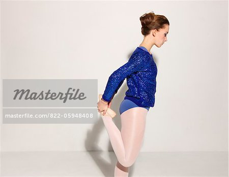 Side View of Ballet Dancer Stretching Leg Stock Photo - Rights-Managed, Image code: 822-05948408