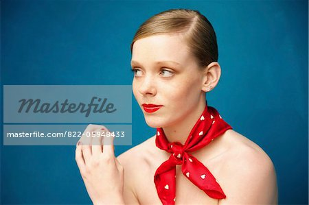 Young Woman with Red Scarf around Neck Stock Photo - Rights-Managed, Image code: 822-05948433