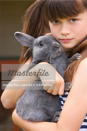 Girl Hugging Grey Rabbit Stock Photo - Rights-Managed, Image code: 822-05948461