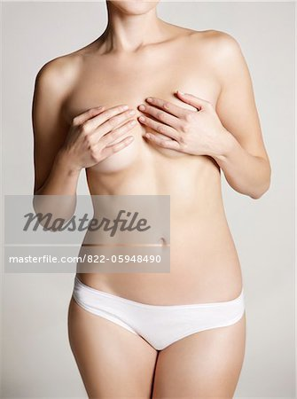 Woman Wearing White Underwear Covering her Breasts Stock Photo - Rights-Managed, Image code: 822-05948490