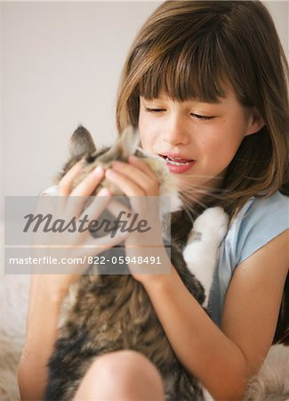 Girl Playing with Cat Stock Photo - Rights-Managed, Image code: 822-05948491
