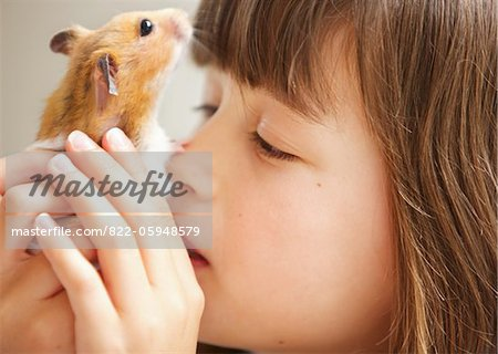 Girl Holding Hamster in front of Face Stock Photo - Rights-Managed, Image code: 822-05948579