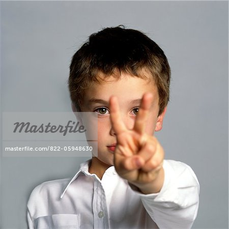 Boy Making Peace Sign Stock Photo - Rights-Managed, Image code: 822-05948630