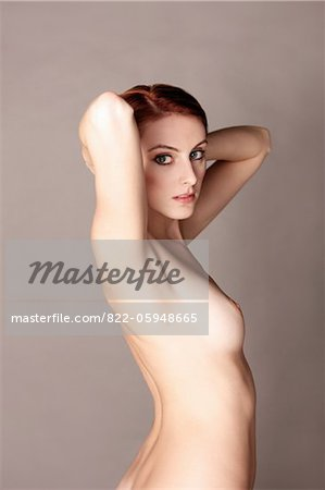 Nude Woman with Arms behind Head Stock Photo - Rights-Managed, Image code: 822-05948665
