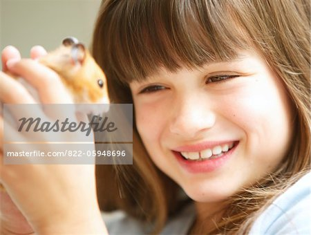 Smiling Girl Holding Hamster Stock Photo - Rights-Managed, Image code: 822-05948696
