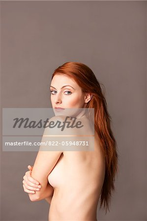 Nude Woman Looking over shoulder Stock Photo - Rights-Managed, Image code: 822-05948731