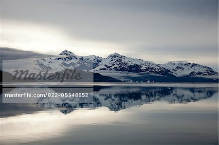 Mountain Range Reflecting on Still Water of Glacier Bay, Alaska, USA Stock Photo - Rights-Managed, Image code: 822-05948852