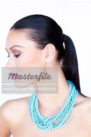 Woman Wearing Purple Lipstick and Turquoise Beads Necklace Stock Photo - Rights-Managed, Image code: 822-06302340