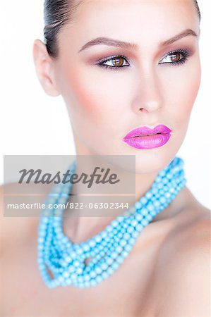 Woman Wearing Purple Lipstick and Turquoise Beads Necklace Stock Photo - Rights-Managed, Image code: 822-06302344