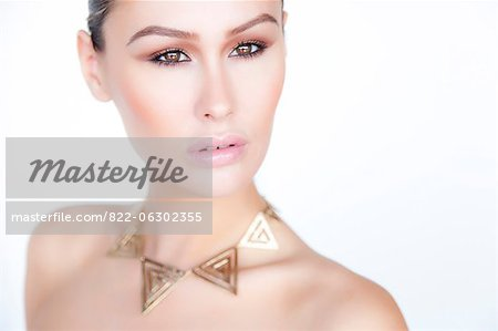 Portrait of Woman Wearing Gold Necklace Stock Photo - Rights-Managed, Image code: 822-06302355