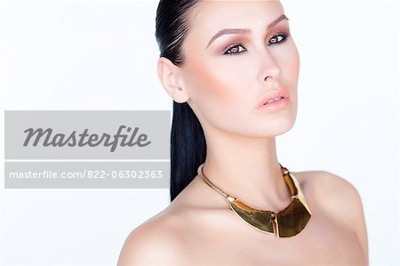 Portrait of Woman Wearing Gold Necklace Stock Photo - Rights-Managed, Image code: 822-06302363
