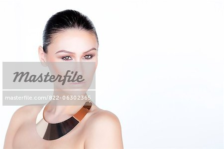 Portrait of Woman Wearing Gold Necklace Stock Photo - Rights-Managed, Image code: 822-06302365