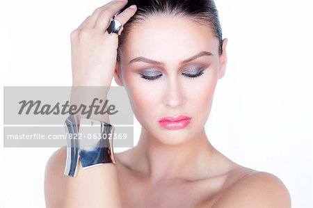 Portrait of Woman Wearing Silver Cuff Jewel Stock Photo - Rights-Managed, Image code: 822-06302369