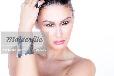 Portrait of Woman Wearing Silver Cuff Jewel Stock Photo - Rights-Managed, Image code: 822-06302370