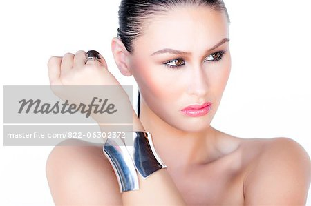 Portrait of Woman Wearing Silver Cuff Jewel Stock Photo - Rights-Managed, Image code: 822-06302372