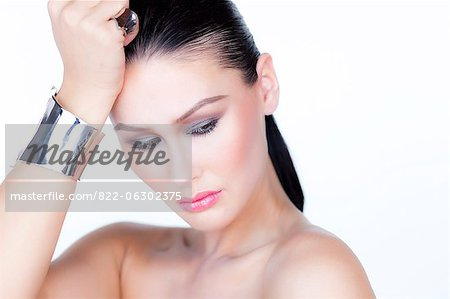Portrait of Woman Wearing Silver Cuff Jewel Stock Photo - Rights-Managed, Image code: 822-06302375