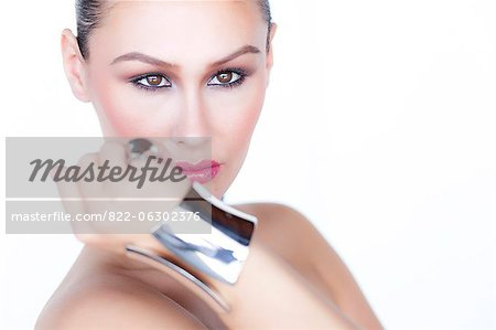 Portrait of Woman Wearing Silver Cuff Jewel Stock Photo - Rights-Managed, Image code: 822-06302376