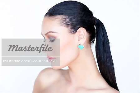Portrait of Woman Wearing Gold Enamel Earring Stock Photo - Rights-Managed, Image code: 822-06302378
