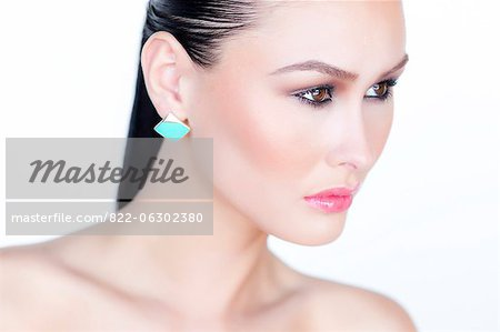 Portrait of Woman Wearing Gold Enamel Earring Stock Photo - Rights-Managed, Image code: 822-06302380