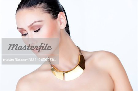 Portrait of Woman Wearing Gold Necklace Stock Photo - Rights-Managed, Image code: 822-06302381