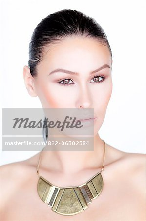 Portrait of Woman Wearing Gold Necklace Stock Photo - Rights-Managed, Image code: 822-06302384